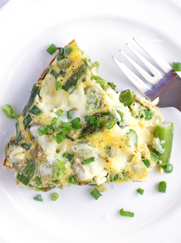 Spring Vegetable & Mozzarella Frittata - A quick & easy frittata recipe with asparagus, peas, fava beans, and green onions. Perfect for brunch or dinner!   heartandstove.com