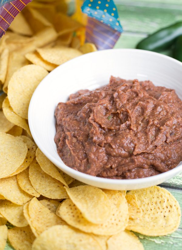 Black Bean Dip - Black beans, jalapeño, and spices make a tasty, protein & fiber filled dip. A fast & easy make-ahead snack! | www.heartandstove.com