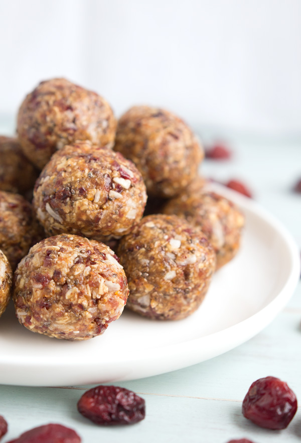 Cranberry Orange Coconut Energy Bites - These no-bake energy bites are packed with the flavors of cranberries, orange, coconut, and vanilla. Perfect recipe for an easy, healthy, gluten-free snack or dessert!   www.heartandstove.com