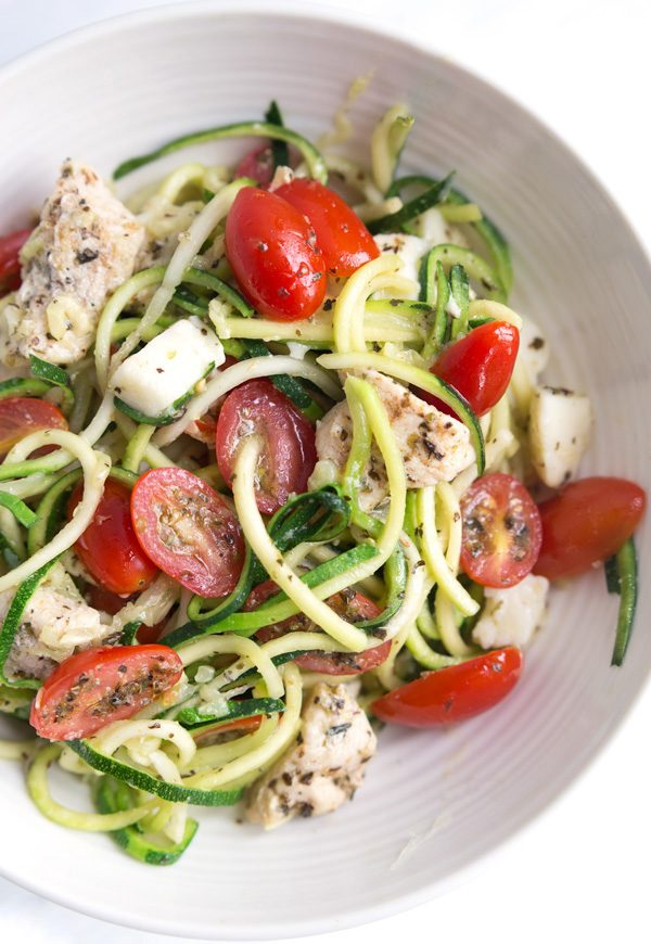 """Chicken Caprese Zoodle Bowls - Lightly sauteed zucchini """"noodles"""" tossed with marinated tomatoes, chicken, and mozzarella. My ALL-TIME favorite zucchini recipe!   www.heartandstove.com"""