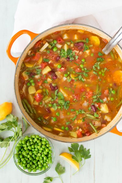 Vegetable Quinoa Soup is full of good-for-you veggies in a savory tomato broth. Potatoes, beans, and quinoa add heartiness and protein. Easily customizable, vegan-friendly (use vegetable stock!), and perfectly warming on a cold winter day!   www.heartandstove.com
