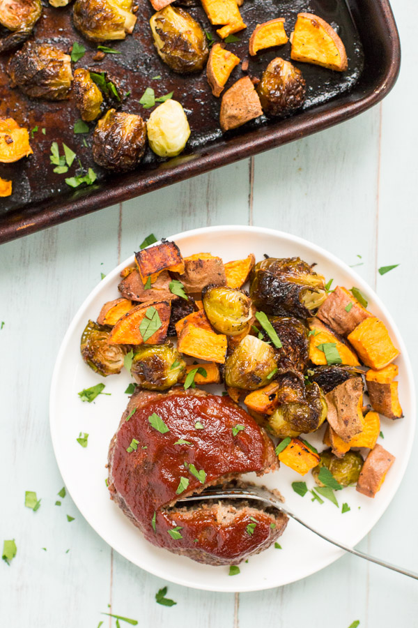 One Pan Mini Meatloaves with Roasted Brussel Sprouts and Sweet Potatoes - Dinner doesn't get more classic than this!   www.heartandstove.com
