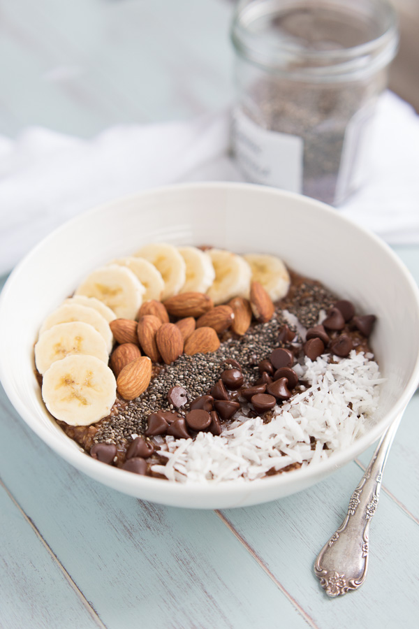 Chocolate Coconut Macaroon Oats - A healthy & filling bowl of chocolate coconut oats with lots of toppings! Like having a bowl of macaroons for breakfast!   www.heartandstove.com