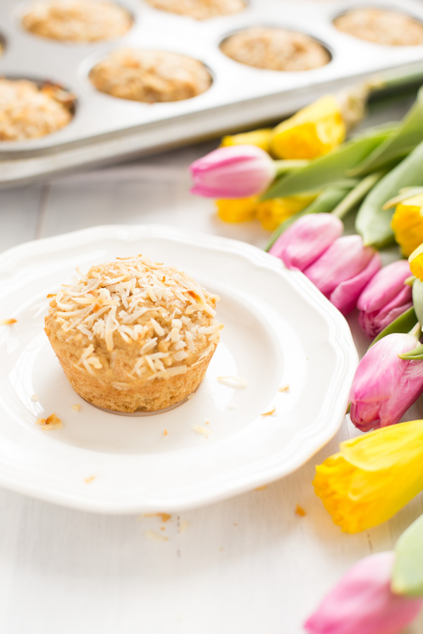 Gluten Free Coconut Muffins - Extra coconut-y muffins made healthier with gluten free flour blend, coconut oil, and coconut sugar.    www.heartandstove.com