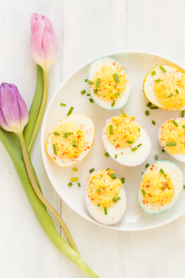 Naturally Dyed, Classically Deviled Eggs - the prettiest addition to your spring holiday spread! Hard boiled eggs are colored pastel with plant-derived DIY dye, then deviled using the easiest 4 ingredient recipe!   www.heartandstove.com