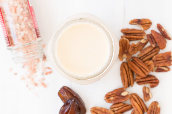 Homemade Pecan Milk - Tastes better than store-bought and couldn't be easier to prepare! Simply soak nuts overnight, blend, and flavor as you wish! Tastes AMAZING in smoothies! | www.heartandstove.com