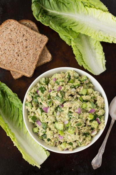 Avocado Veggie Tuna Salad is a more nutritious, mayo-less alternative to traditional tuna salad. The addition of cucumbers, red onion, and scallions is light and refreshing with delicious crunch! Perfect for lunches, snacking, and picnics!   www.heartandstove.com