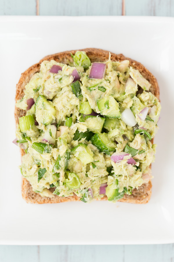 Avocado Veggie Tuna Salad is a more nutritious, mayo-less alternative to traditional tuna salad. The addition of cucumbers, red onion, and scallions is light and refreshing with delicious crunch! Perfect for lunches, snacking, and picnics! | www.heartandstove.com