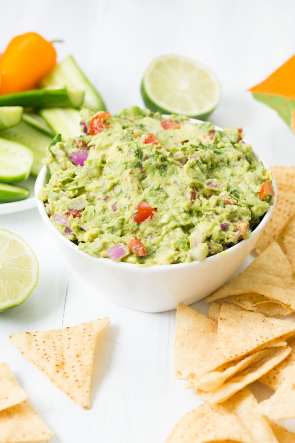 Classic Guacamole is a classic - tomatoes & red onion add crunch, cilantro & lime provide bright freshness, and jalapeño adds a little heat.