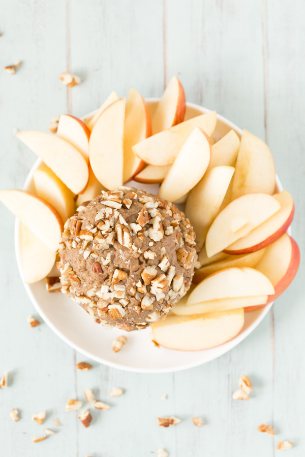 Pecan Nut Butter Ball is an all natural, sweet/salty nut butter treat perfect for spreading on sliced apples. DIY pecan butter is flavored with dates, vanilla extract, cinnamon, and sea salt. A healthy snack and dessert option! | www.heartandstove.com