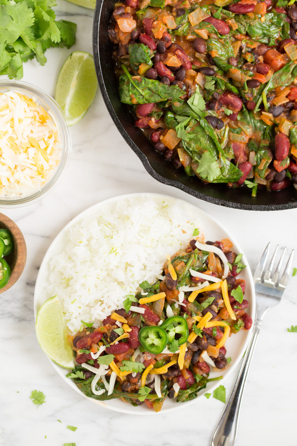 Salsa Beans and Rice is a Tex-Mex take on classic beans and rice. Black and kidney beans are simmered with veggies, salsa, and seasonings for a protein and veggie packed main dish perfect for Meatless Mondays! | www.heartandstove.com