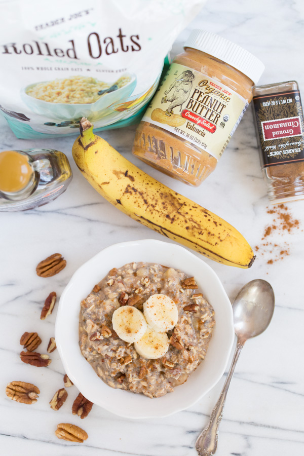 Nutty Banana Overnight Oats is a filling and healthy make-ahead breakfast recipe. Rolled oats, nut butter, chopped nuts, and banana soak in milk and chia seeds for a hearty, chilled breakfast bowl! | www.heartandstove.com