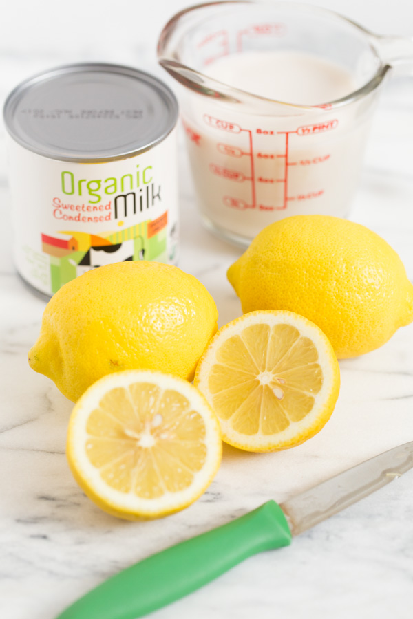 Lemon Cream Popsicles - the perfect combo of sweet & tart! Only 3 ingredients to these homemade pops! If you like lemon cream pie, you'll LOVE these! | www.heartandstove.com