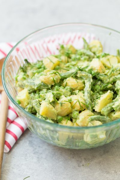 Avocado Potato and Veggie Salad - a mayo-free & green veggie packed alternative to traditional potato salad. Gold potatoes, asparagus, green beans, and peas are tossed in a creamy avocado and lemon dressing and fresh herbs.   www.heartandstove.com