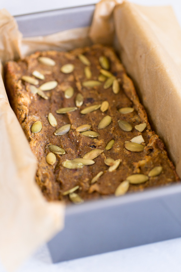 Coconut Flour Pumpkin Harvest Bread is a healthier treat (gluten-free, naturally sweetened) and full of fall flavor perfect for breakfast or dessert! Think pumpkin, bananas, maple syrup, pecans, dried cranberries, pumpkin seeds, plus chia seeds & ground flax for extra omega-3 fats. | www.heartandstove.com