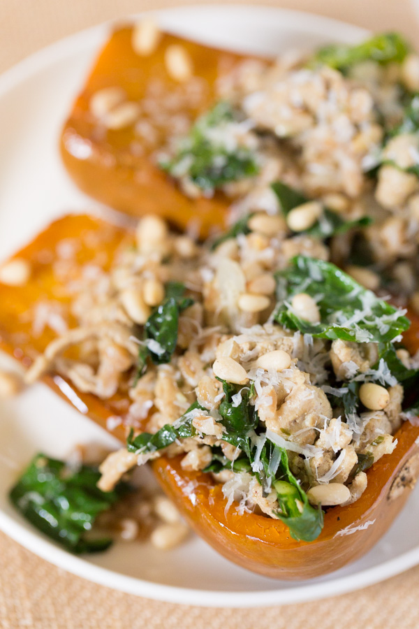 Turkey and Farro Stuffed Honeynut Squash is full of fall flavor! A mixture of ground turkey,farro, kale, parmesan cheese, and seasoning top roastedhoney nut squash for a healthy, protein and fiber packed meal. It's like healthy Thanksgiving in one bite! | www.heartandstove.com