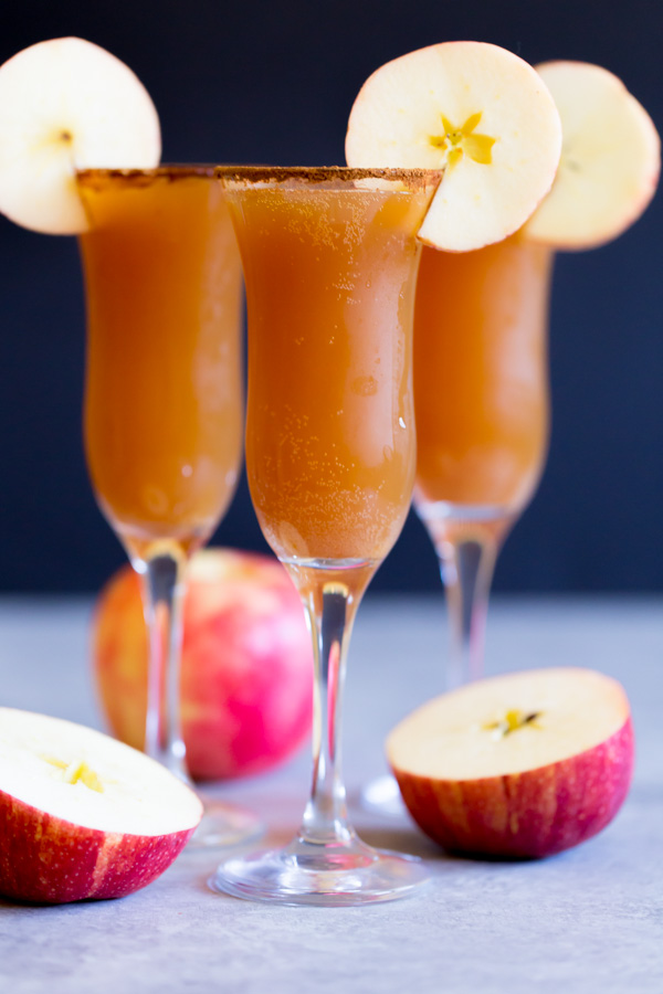 Apple Cider Mimosas are a seasonal twist on the classic mimosa. It's the perfect cocktail for Halloween, Thanksgiving, or weekend brunches! | www.heartandstove.com