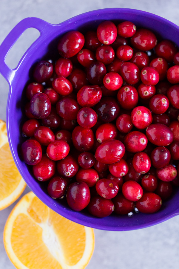 Three Ingredient Cranberry Sauce - What's Thanksgiving without a bowl of colorful, sweet-tart cranberry sauce on the table? This Three Ingredient Cranberry Sauce balances fresh, tart cranberries with orange and maple syrup AND requires only 10 minutesto make! | www.heartandstove.com