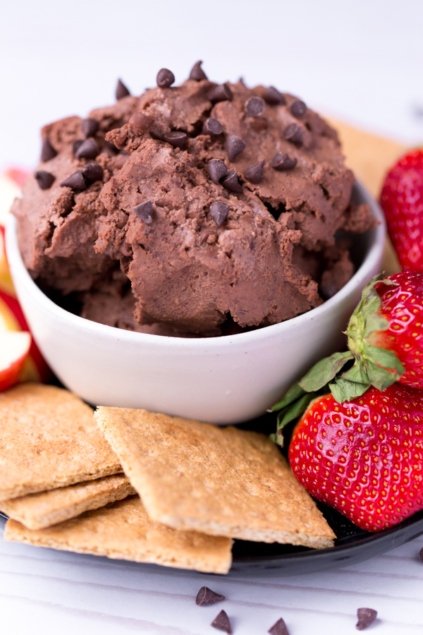 Chocolate Brownie Hummus is a healthy dessert made from black beans spread. Pairs perfectly with fruit, crackers, or pretzels! | www.heartandstove.com