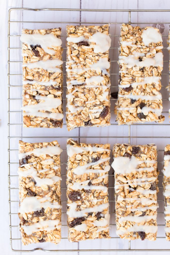 Iced Oatmeal Raisin Granola Bars - Chewy and studded with raisins, these homemade granola bars have all the flavors of the classic oatmeal cookie! | www.heartandstove.com