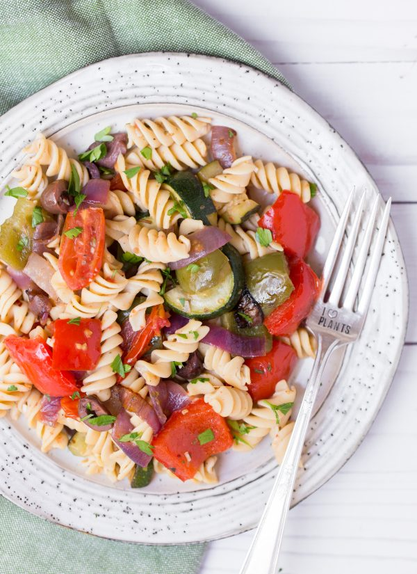 Roasted Greek Veggie Pasta Salad - Roasted veggies tossed with Banza's chickpea pasta and a Greek inspired vinaigrette is an easy, filling, plant-based meal! | www.heartandstove.com