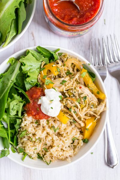 Salsa Verde Pulled Chicken Burrito Bowls: Store bought salsa verde makes this tasty pulled chicken dish extra easy! Add greens and seasoned rice to create simple, healthy burrito style bowls.   www.heartandstove.com