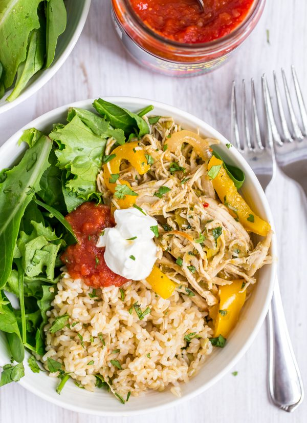 Salsa Verde Pulled Chicken Burrito Bowls: Store bought salsa verde makes this tasty pulled chicken dish extra easy! Add greens and seasoned rice to create simple, healthy burrito style bowls. | www.heartandstove.com
